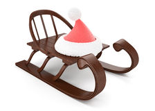 Wooden sleigh and cristmas hat Royalty Free Stock Photo