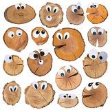 Wooden slices with funny faces. With various grimaces stock images