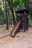 Wooden slide with wooden house. In the park stock images