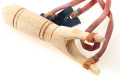 Wooden slingshot with elastic Stock Image