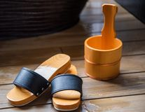 Wooden slippers and a barrel for accessories, Hanoke, Japan. Close-up. stock photo