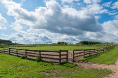 Wooden slit rail fence in the pasture Royalty Free Stock Photography