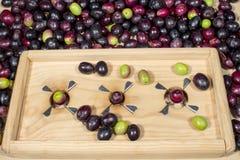 Wooden slitter for preparing seasoned slit olives Stock Photos