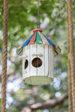 The wooden small birdhouse hanging on tree with blurred natural Royalty Free Stock Photography