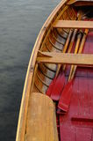Wooden small boat and red paddles stock photos