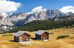 Wooden small cabin in dolomities alps mountains Stock Images