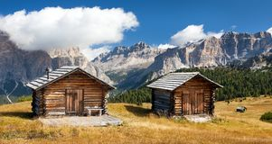 Wooden small cabin in dolomities alps mountains Stock Photos
