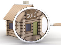 Wooden small house and magnifier. Stock Photos