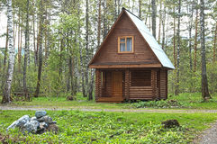 Wooden small house in a wood. For travellers Royalty Free Stock Images