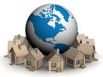 Wooden small houses round globe. Royalty Free Stock Images