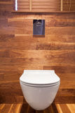 Wooden small toilet interior Royalty Free Stock Image