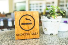 Wooden Smoking Area with Mini Tree Pot Royalty Free Stock Photo
