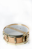 Wooden snare drum with gold rims Stock Photo