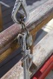 Wooden block,ropes Stock Photos