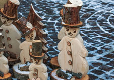 Wooden snow men. Wooden snow   men on the cobbles Royalty Free Stock Photo
