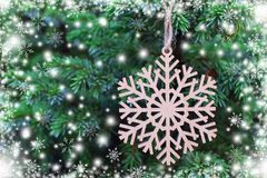 Wooden snowflake on christmas tree stock illustration