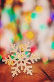 Wooden Snowflake on colorful boke background with copy space, se Stock Image