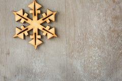 Wooden snowflake on retro background Royalty Free Stock Photos