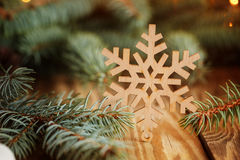 Wooden Snowflake on Wooden Table with brunch pine. Christmas bac Stock Photo