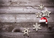 Wooden snowflakes and stars on old dark background Royalty Free Stock Images