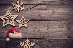 Wooden snowflakes and stars on old dark background Stock Photos