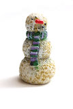 Wooden Snowman. A wooden snowman figurine on white background Royalty Free Stock Photos