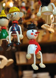 Wooden snowman. Small wooden snowman hanging by its spring among other items Royalty Free Stock Photo