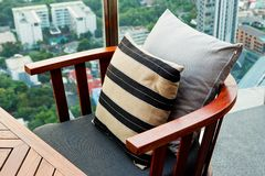 Wooden sofa in the lounge. A garden setting Stock Image