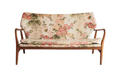Wooden sofa upholstered in floral fabric printed, vintage style Royalty Free Stock Images