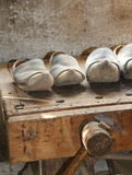 Wooden soled type dutch clogs and a wooden vise Royalty Free Stock Photo