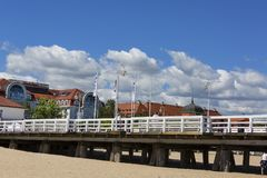 Wooden Sopot pier in sunny day, Sopot, Poland. SOPOT, POLAND - JUNE 6, 2018: Wooden Sopot pier in sunny day. It is the longest wooden pier in Europe, 511,5 m stock photography