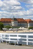 Wooden Sopot pier in sunny day, view of the Grand Hotel, Sopot, Poland. SOPOT, POLAND - JUNE 6, 2018: Wooden Sopot pier in sunny day, view of the Grand Hotel royalty free stock photos