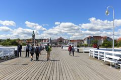 Wooden Sopot pier in sunny summer day, Sopot, Poland. SOPOT, POLAND - JUNE 6, 2018: Wooden Sopot pier in sunny day. It is the longest wooden pier in Europe, 511 Stock Photo