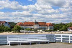 Wooden Sopot pier in sunny summer day, view of the Grand Hotel, Gdansk, Poland. SOPOT, POLAND - JUNE 6, 2018: Wooden Sopot pier in sunny day, view of the Grand Stock Images