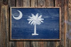 Wooden South Carolina flag. 3d rendering of a South Carolina State USA flag on a wooden frame and a wood wall Royalty Free Stock Photos