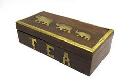 Wooden asian tea box with gold elephants isolated on white Royalty Free Stock Photos