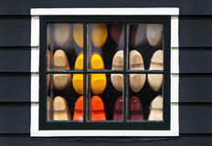 Wooden souvenir clogs behind a window Stock Images
