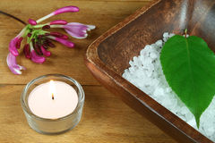 Wooden SPA. Spa resort therapy composition, candle, honeysuckle flower, leave and salt crystals Royalty Free Stock Images