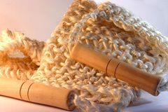 Wooden spa item. Tool for massage, wood and roughly knitted rope Royalty Free Stock Image