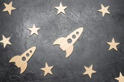 Wooden space rocket and stars on a dark background. The concept of space travels, the study of planets and stars. Education stock images