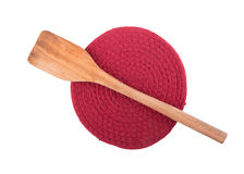 Wooden spatula on dark red knit pot holder Royalty Free Stock Image