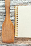 Wooden spatula, notebook and ribbon Stock Image