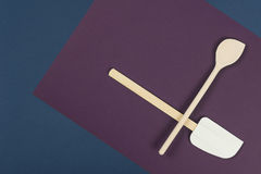 Wooden spatula and spoon on a blue napkin Royalty Free Stock Photos