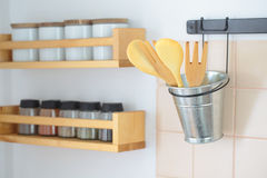 Wooden spatulas and rack with spices Royalty Free Stock Photography