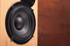 Wooden speaker. On the darckbackground Stock Photos