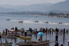 Wooden speed boat race in Cagayan De Oro City. Cagayan De Oro City, Philippines - August 28, 2013: Thousands of spectators witnessed the racing of motorized royalty free stock photography