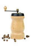 Wooden spice handmill and allspice Royalty Free Stock Photography