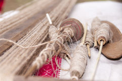 Wooden spindles with hemp threads Royalty Free Stock Images