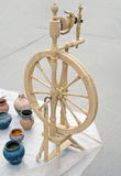 Wooden spinning wheels and old jugs Stock Photography