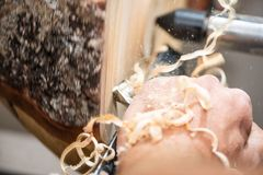 Wooden spiral shavings while wood tunery with chisel. While makling a bowl royalty free stock image